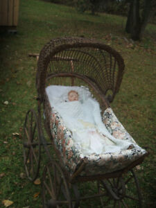 Very old rattan baby carriage  Ca. 1890 with wooden wheels.