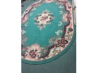 Second-hand acrylic oval rug decorated with roses.