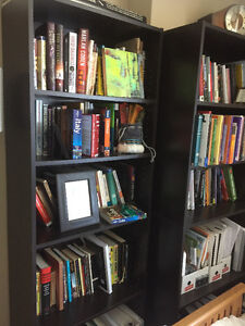 Black office chair and 2 brown 4shelf bookcases