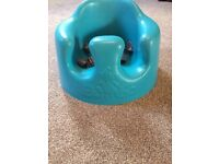 Blue bumbo seat with tray