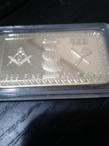 Gold clad bar with designs