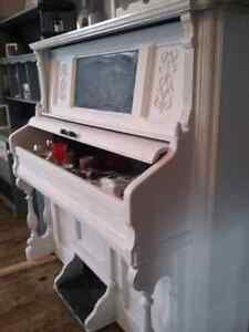 Refinished gutted piano bar