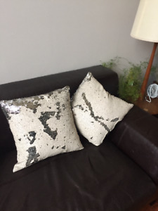 silver and beige pillows