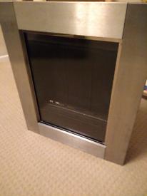 Silver wall mounted flueless gas fire