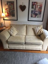 Cream sofa and foot stool
