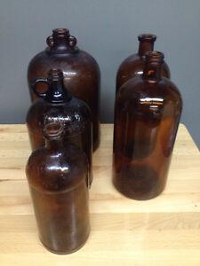 Lot de 5 cruches antiques ambres brunes 2 javex   la plus grosse