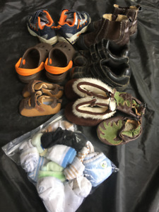 7 pairs of baby/toddler shoes & socks- size newborn- 7