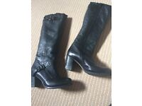 Black winter boots with a heel size 5 like new