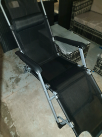 A new stylish black full reclining 2 in 1 folding sun lounger.