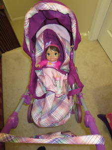 Stroller with baby doll and 2 milk bottles