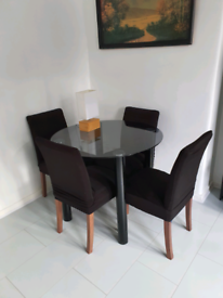 Black dining table and 4 chairs