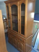 Beautiful hutch and kitchen table with a leaf and 3 chairs