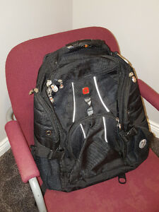 SWISS CROSS LAPTOP BACKPACK WITH AUDIO POCKER AND HEADPHONE JACK