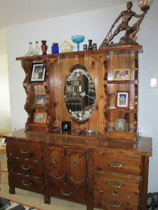 chest of drawers with mirrored display hutch