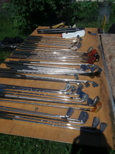 40 GOLF CLUBS, 2 bags, and two wheeled carts & more