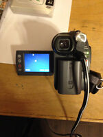 Sony mini DVD camcorder with case and 7 discs