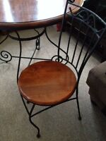 Round wood table with wrought iron base