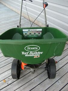 Seeder or Fetilizer spreader plus a bag of Turf Builder