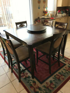 Tall wooden dining table with 6 chairs