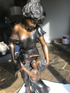 Mother and Children Statue