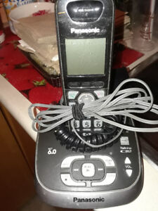 Cordless-Phone-Answering Machine all in one-see the photo's.