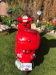 VESPA - not just a scooter, they're a Lifestyle.  Think Italy.