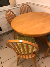 Free Extending wooden table with 4 chairs.