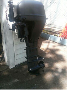 9.9 HP Evinrude/Johnson outboard motor four stroke long shaft