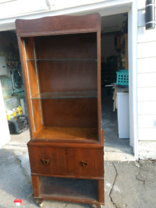 Wood cabinet. 2 glass shelves on casters
