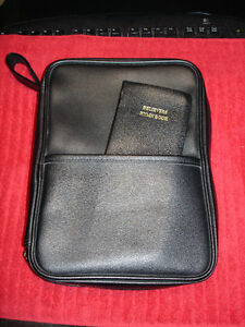 Bible in leather case with believers Hymn Book