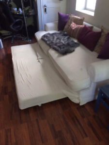 FREE THIS MORNING -- Large ikea couch with roll out trundle bed