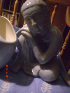 Serene Buddha from Thailand sky blue with small vase