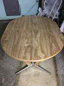solid dinning table and an antique desk