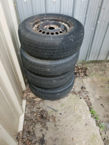 4 Chevy Cavalier tires with rims.