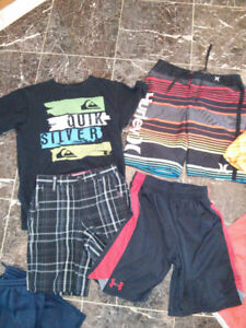 Box of boys clothes sizes 10-12, a couple 8-10, brand name