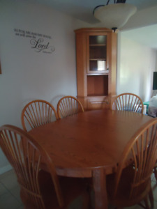 Beautiful dining table  6 chairs and custom made corner hutch