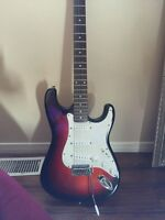 Electric guitar with mini amp.