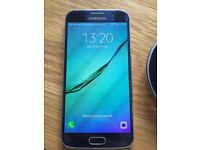Samsung Galaxy S6 in black (32Gb) and wireless charge pad