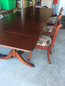 Big hardwood dining room table with chairs