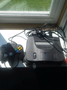 nintendo 64 with 6 games and two controllers