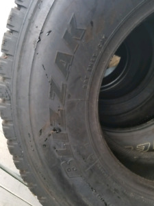 one Bridgestone Blizzak 265/75R16 tire