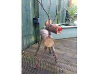 Handmade log reindeer