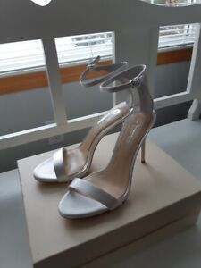 New satin white high heeled sandals size 9