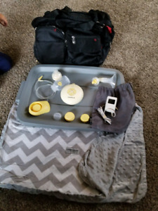 Medela breast pump, diaper bag and carseat canpoy