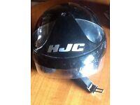 Black H J C motorbike helmet size large.
