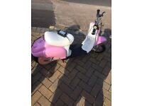 Pink and white kid moped