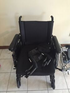 Wheel chair with special leg rests