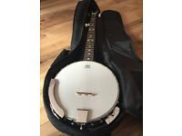 BRAND NEW Remo weatherking banjo, 5 string, new used, with carrying case, excellent deal.