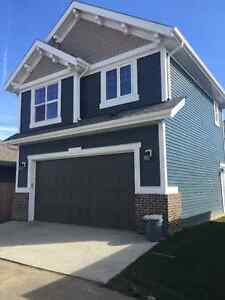 Garage suite for rent in Griesbach. All utilities included !