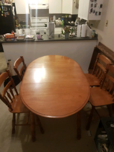 Round hardwood table and 4 chairs